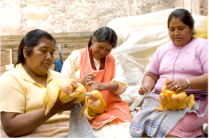Mexican women preparing for a wedding